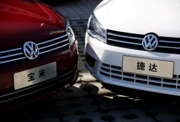 Volkswagen's Bora and Jetta models are displayed outside its dealer shop in Beijing. Photo: Reuters/Kim Kyung-Hoon