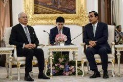 Malaysian Prime Minister Najib Razak is received by Thai Prime Minister Prayuth Chan-Ocha at Government House in Bangkok