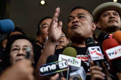 Red Shirt leader Jatuporn Prompan (2nd R) at a press conference before reporting to police in Bangkok on August 2, 2016. AFP, Lillian Suwanrumpha