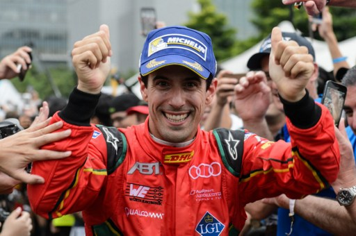Lucas di Grassi of Brazil arrives at the podium after finishing second in the Formula E championship in Hong Kong on October 9, 2016. AFP, Anthony Wallace