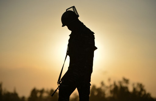 An Indian paramilitary trooper on patrol in Jammu and Kashmir. Photo: AFP