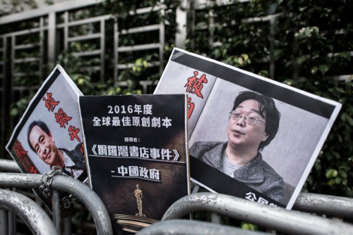 Placards showing missing bookseller Gui Minhai (R) and his associate Lee Bo (L) that were left by members of the Civic party outside the China liaison office in Hong Kong on January 19, 2016. AFP
