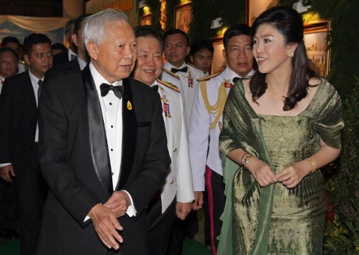 This handout picture taken by Government House on January 19, 2012 shows Thai Prime Minister Yingluck Shinawatra (R) talking with General Prem Tinsulanonda (L), President of the Privy Council, during a gala dinner on the occasion of the Royal Thai Army Day at the Thai Army Club in Bangkok. AFP