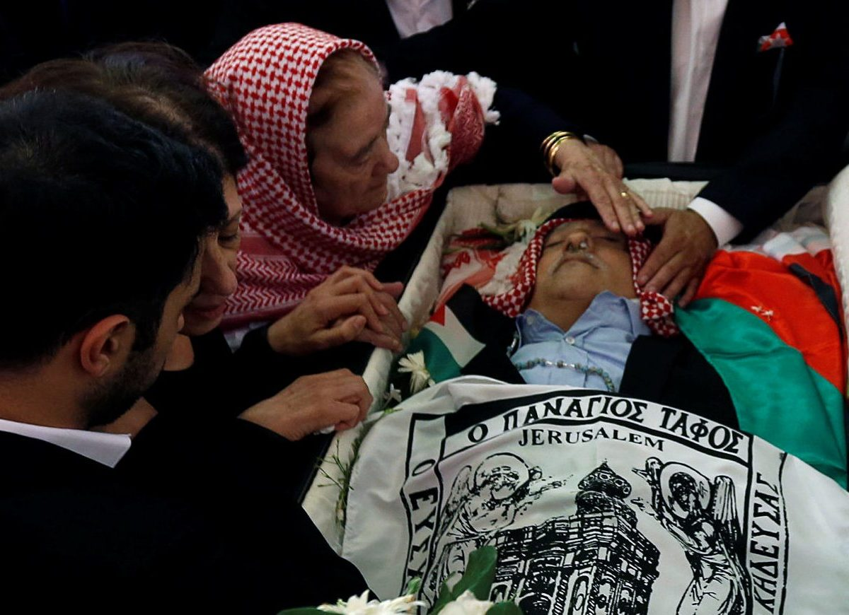 Nabiha Hattar, the mother of Jordanian writer Nahed Hattar, who was shot dead, takes a farewell look during his funeral in the town of  Al-Fuheis near Amman, Jordan, September 28, 2016. REUTERS/Muhammad Hamed