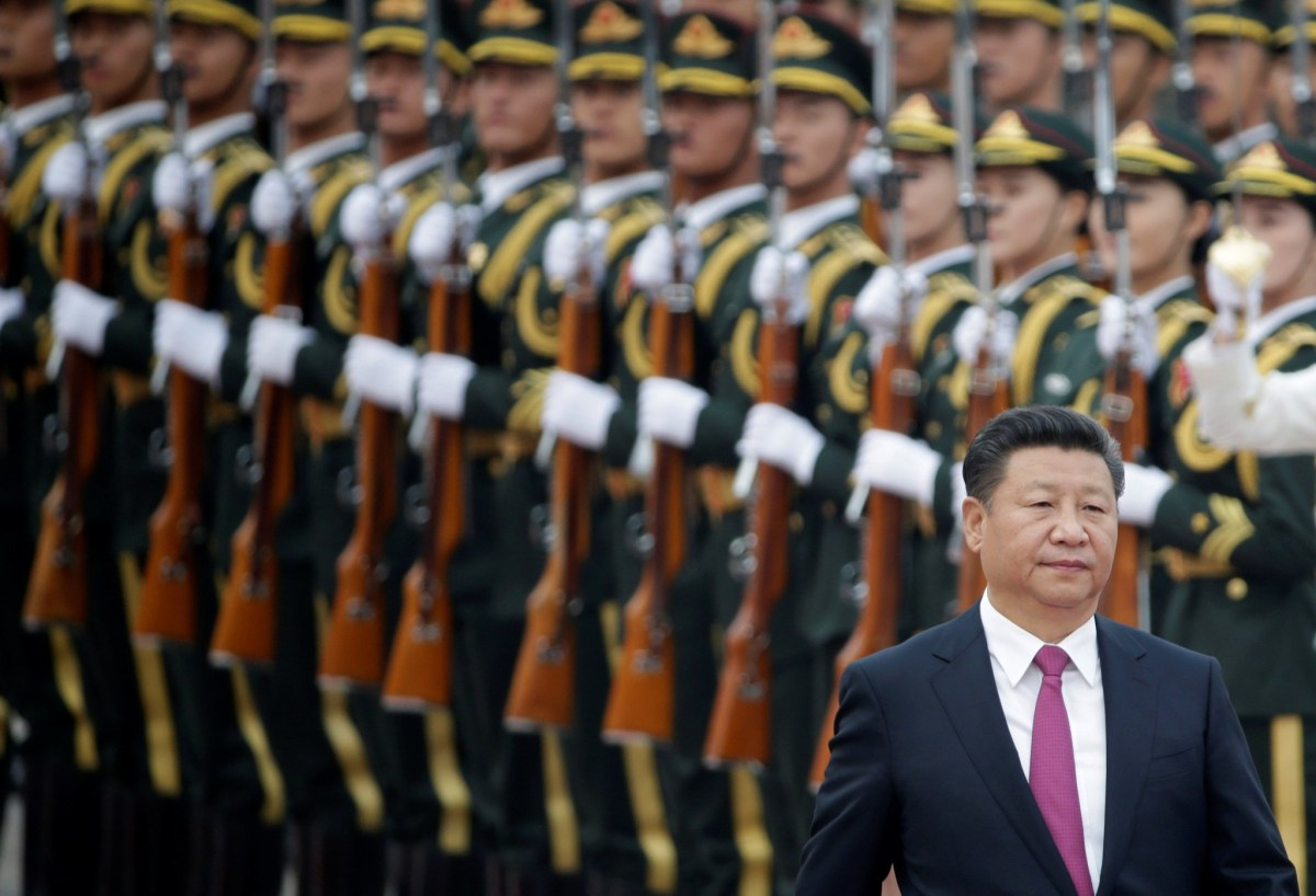 Chinese President Xi Jinping is seen in front of a PLA guard of honour. Photo: REUTERS/Jason Lee