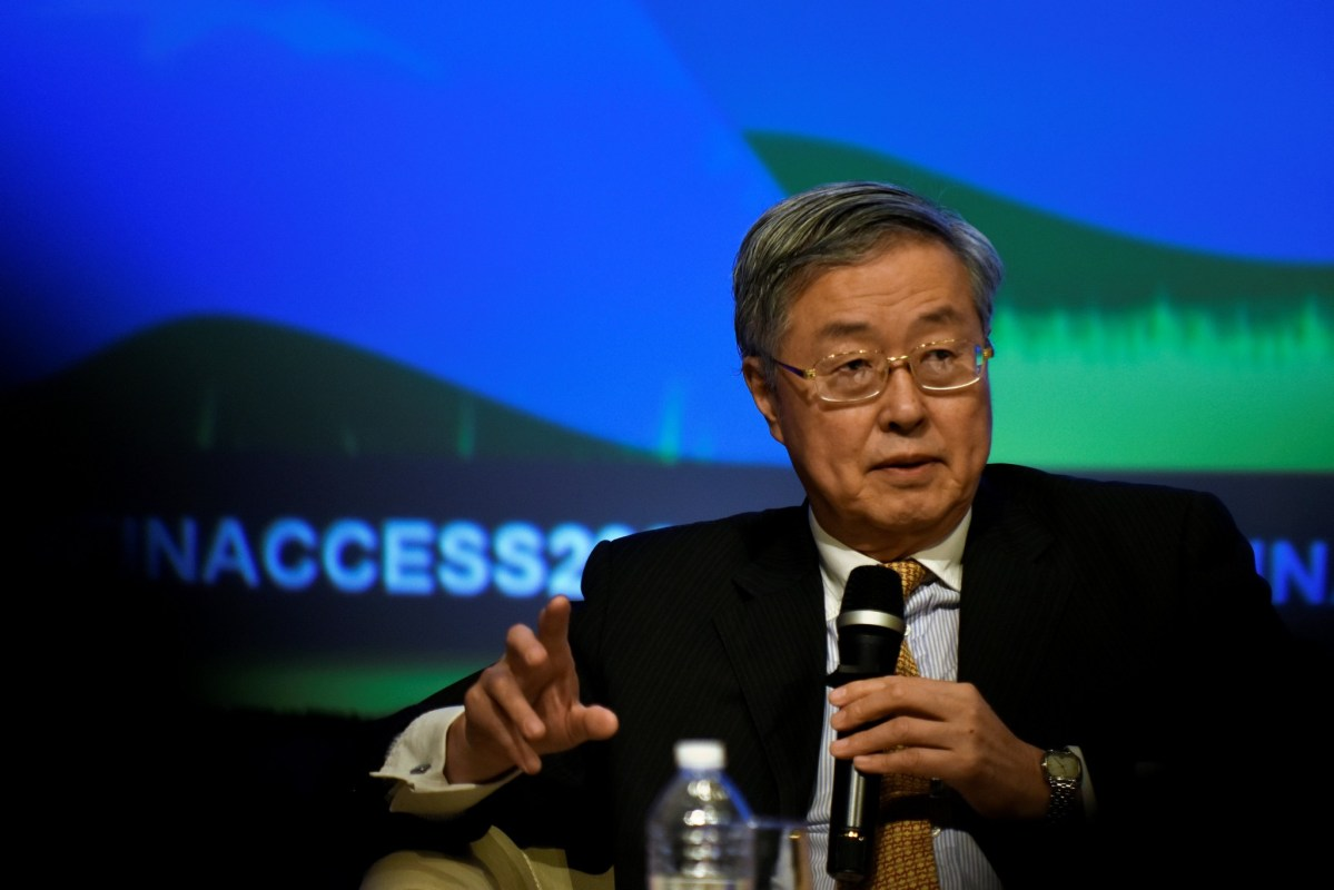 People's Bank of China Governor Zhou Xiaochuan speaks on a panel at the annual meetings of the IMF and World Bank Group in Washington on October 7, 2016. Reuters