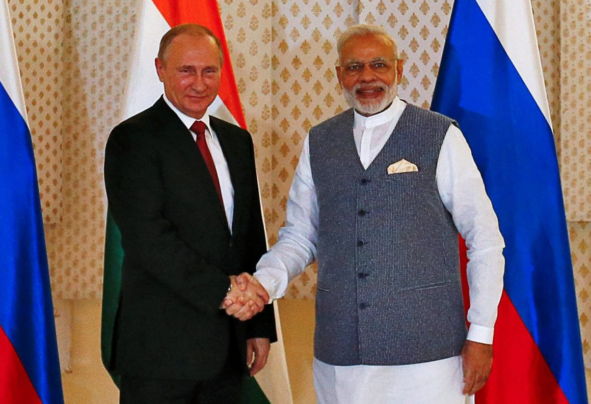 Russian President Vladimir Putin shakes hands with Indian Prime Minister Narendra Modi. Putin is flexible and pragmatic but harshly unwavering on Russian interests. Photo: Reuters/ Danish Siddiqui