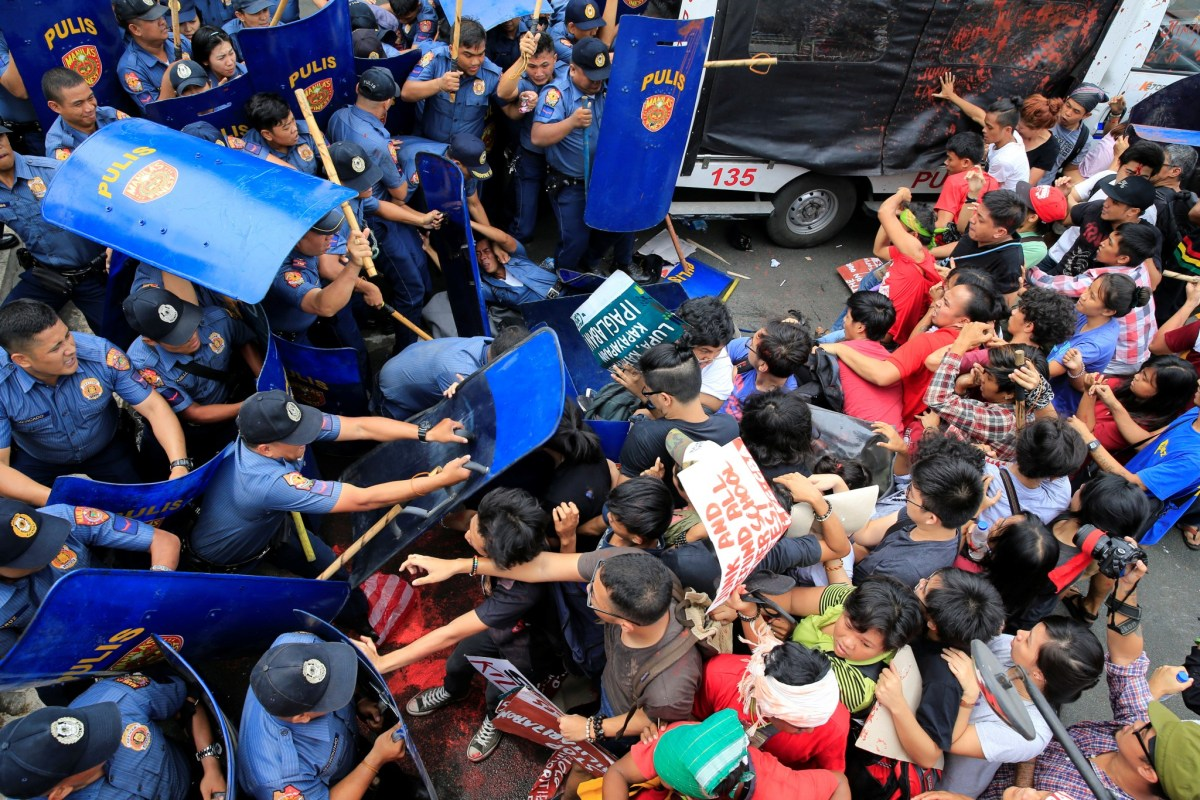 Various activist groups clash with anti-riot policemen in front of the US Embassy in Manila during a protest against the continuing presence of US troops in the Philippines. Photo: REUTERS/Romeo Ranoco