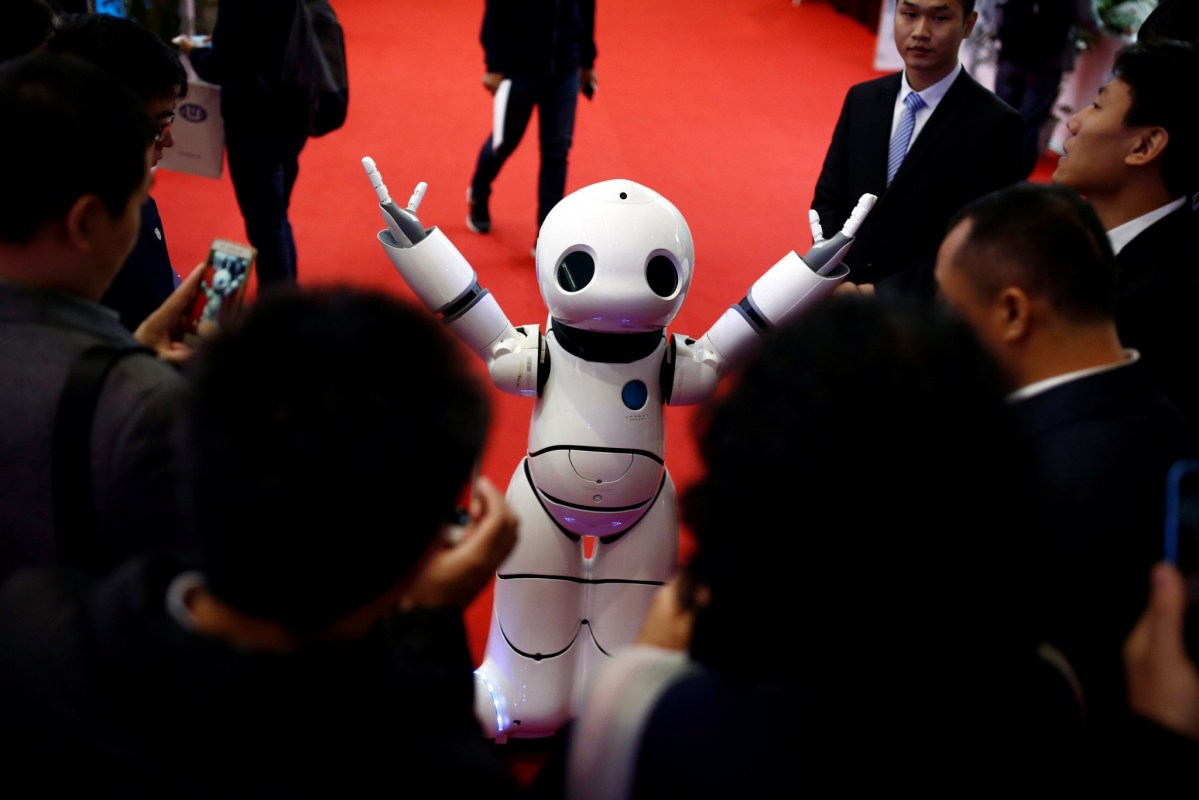 A humanoid robot can be used to help elderly suffering from dementia. Photo: Reuters/Thomas Peter