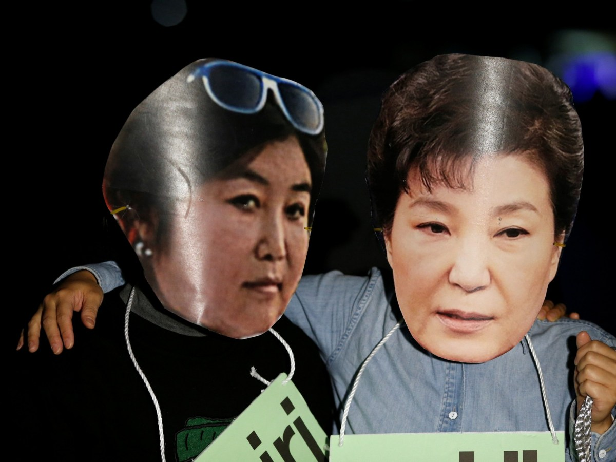 Protesters wearing cut-outs of South Korean President Park Geun-hye (right) and her close friend Choi Soon-sil attend a protest denouncing influence-peddling. Photo: Reuters