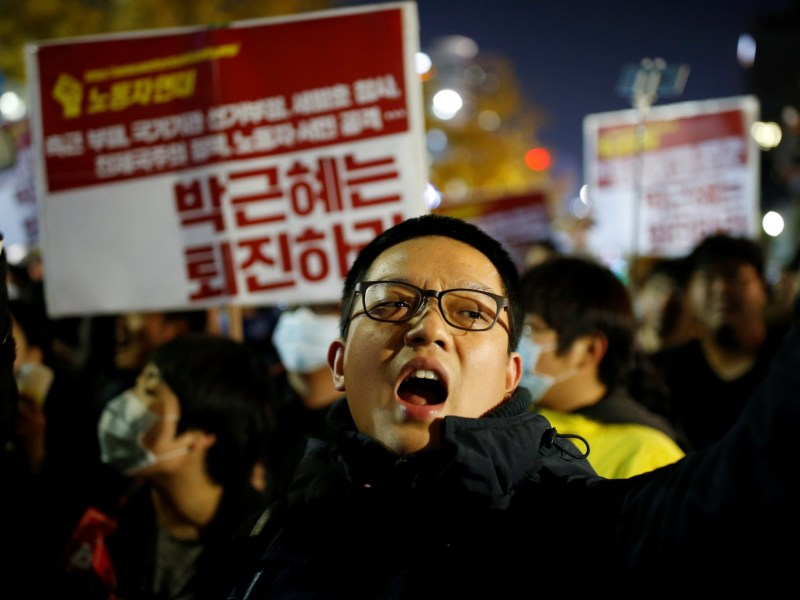 "A protester chants slogans during a protest denouncing South Korean President Park Geun-hye over a recent influence-peddling scandal in central Seoul, South Korea, October 29, 2016. The banner reads, ""Call for Park Geun-hye to step down."" Photo: REUTERS/Kim Hong-Ji"
