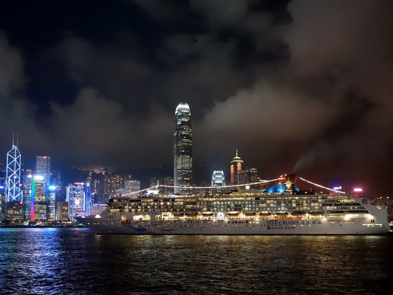A night view of a cruise ship in Victoria Harbor. Photo: Wikimedia Commons