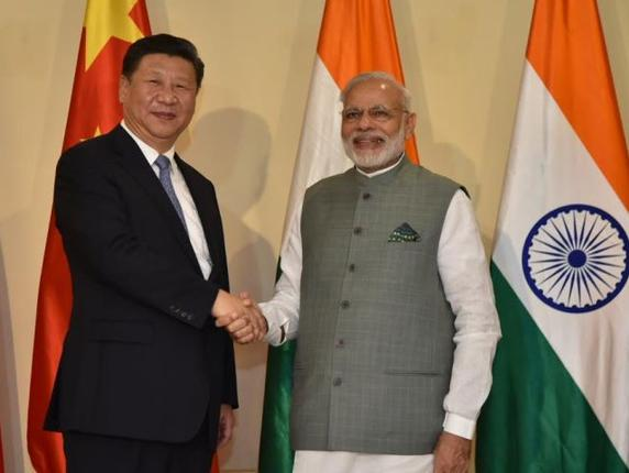 Indian Prime Minister Narendra Modi (right) and Chinese President Xi Jinping greet each other before holding bilateral talks on the sidelines of the BRICS summit.
