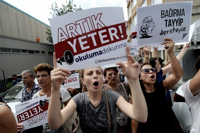 Protestors march with placards reading 'Enough! Don't turn our schools into Imam Hatips' in Istanbul this summer. Photo: AFP