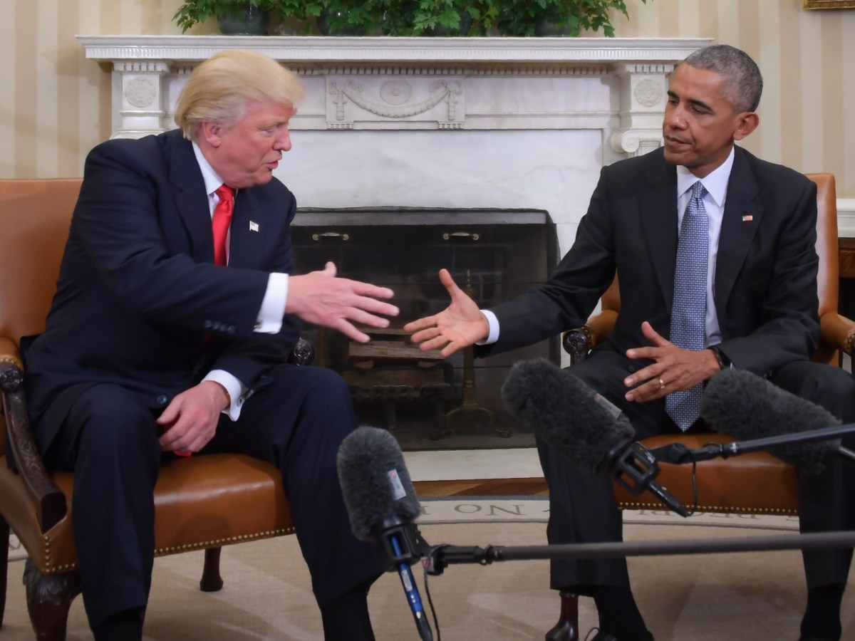US President Barack Obama and Republican President-elect Donald Trump shake hands during a transition planning meeting in the Oval Office at the White House. Photo: AFP/Jim Watson