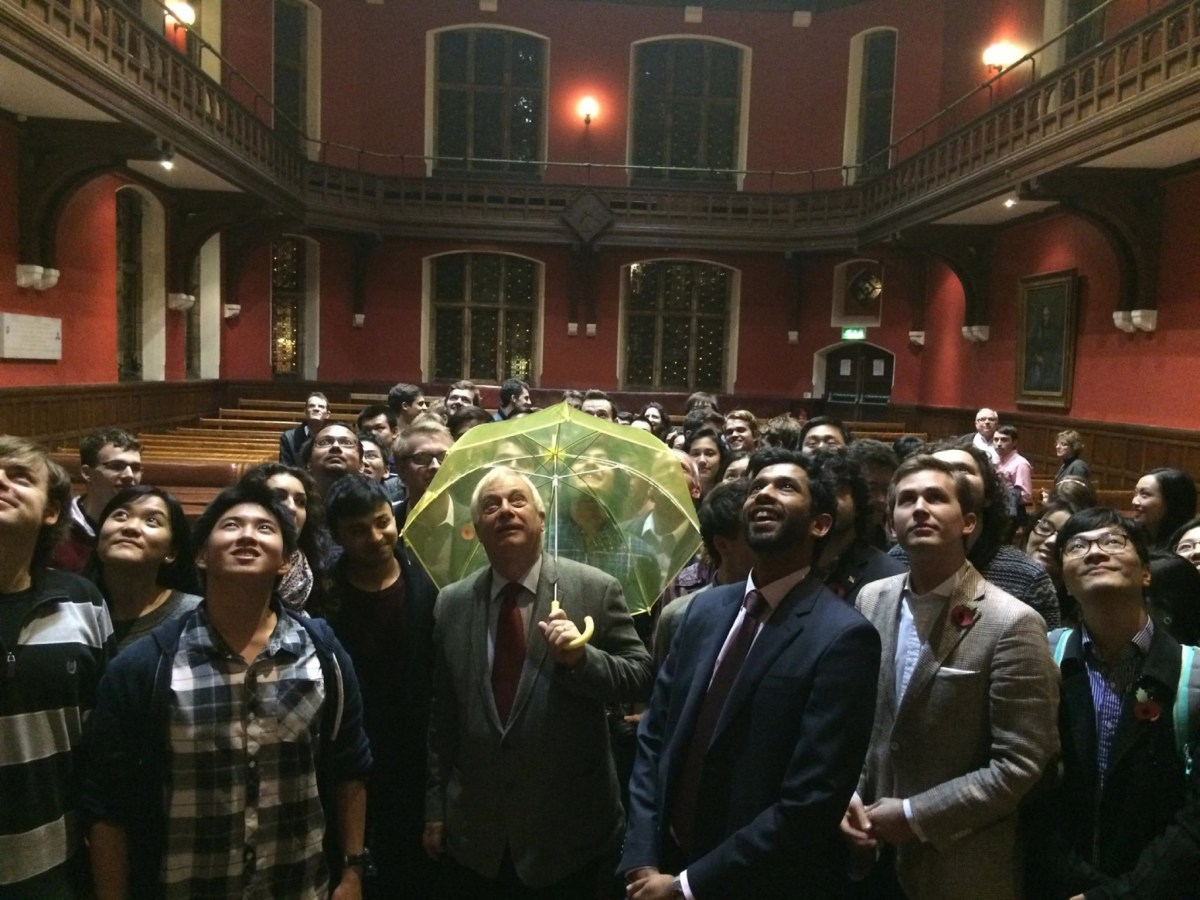 Hong Kong's last British governor Chris Patten holds a yellow umbrella symbolizing the Occupy Central movement in Hong Kong during an Oxford Union event in London, UK, on November 1, 2014. Photo: AFP/Oxford Union/EyePress