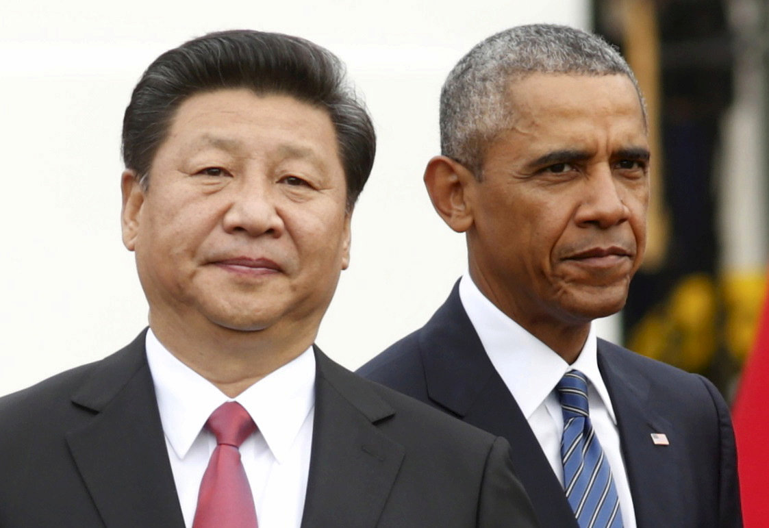 Then US President Barack Obama stands with Chinese President Xi Jinping at the White House on September 25, 2015.  Photo: Reuters / Kevin Lamarque