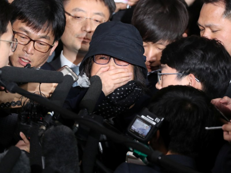 Choi Soon-sil, who is involved in a political scandal, reacts as she is surrounded by the media upon her arrival at a prosecutor's office in Seoul, South Korea. Photo: Seo Myeong-gon/Yonhap via Reuters