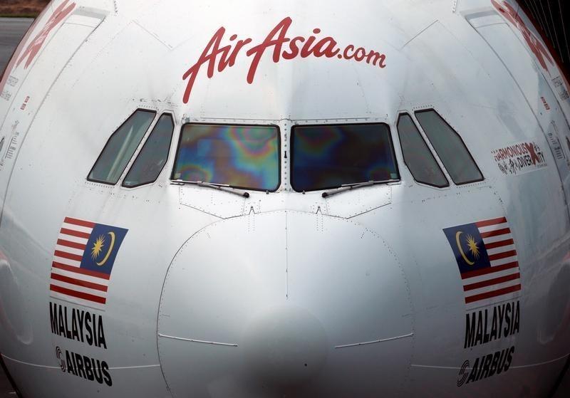 An AirAsia plane sits on the tarmac at Kuala Lumpur International Airport, Malaysia August 28, 2016. Photo: Reuters/Edgar Su