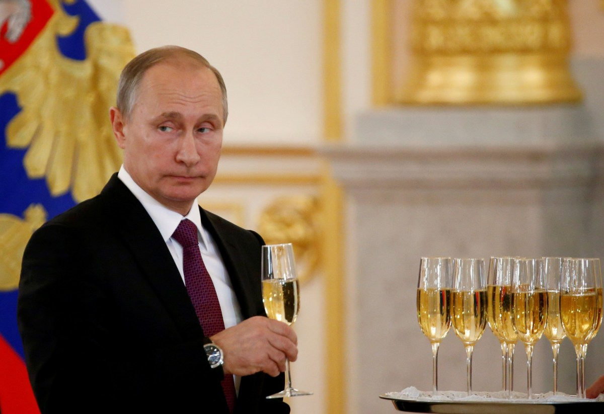 Vladimir Putin has many things to toast internationally, but domestic unrest is growing. Photo: Reuters/Sergei Karpukhin