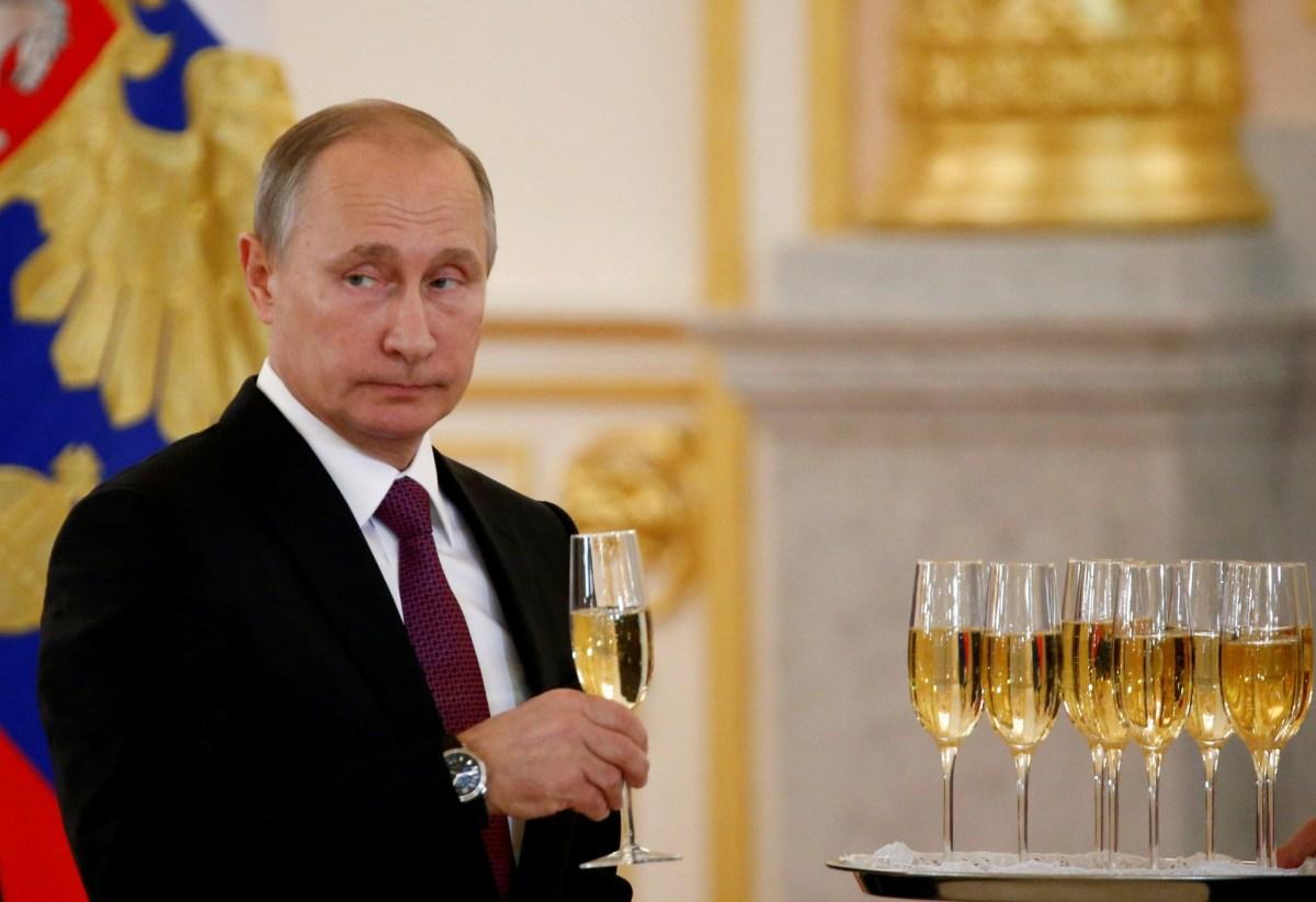 Vladimir Putin has many things to toast internationally, but domestic unrest is growing. Photo: Reuters/Sergei Karpukhin