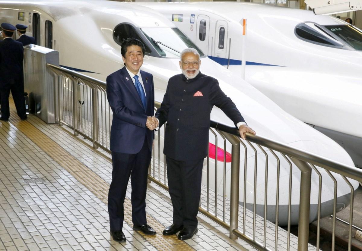 Indian Prime Minister Narendra Modi and Japan's Prime Minister Shinzo Abe pose in front of Shinkansen bullet train before heading for Hyogo prefecture at Tokyo Station Japan November 12, 2016.  Kyodo/via Reuters