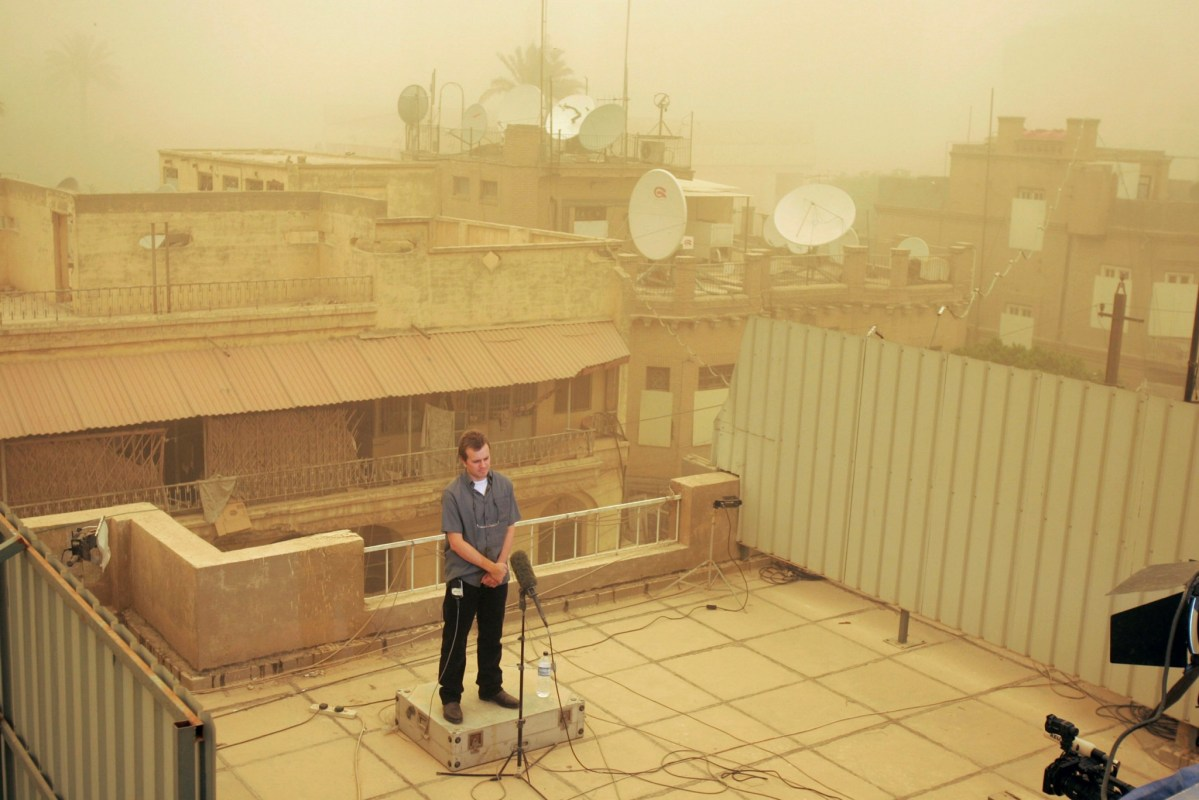 Iraq bureau chief Dean Yates stands on the roof of the Baghdad bureau as he does a live rehearsal with the New York office as part of events marking the first day of Thomson Reuters, in Baghdad, Iraq, April 17, 2008. Photo: Reuters/Mahmoud Raouf Mahmoud