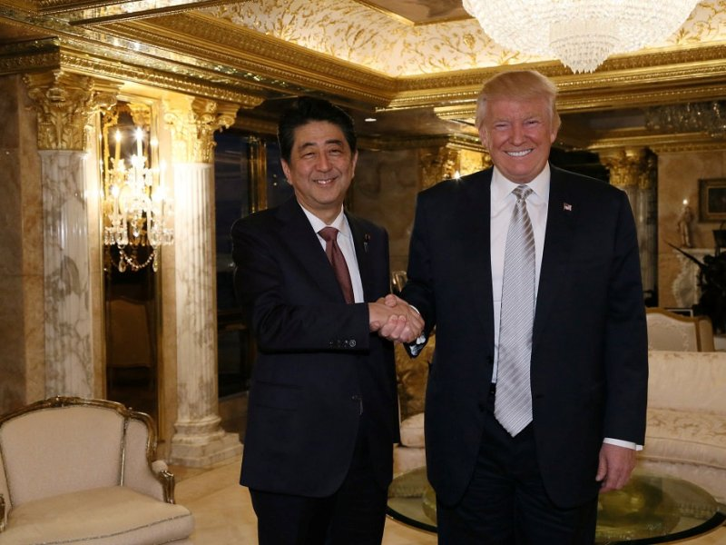 The handshake: Abe & Trump. Photo: Cabinet Public Relations Office/via Reuters
