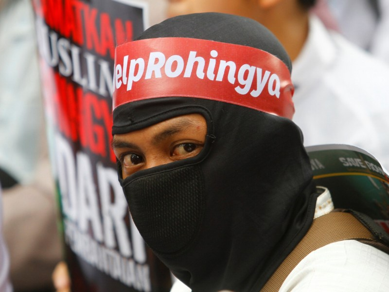 "A protesters wears a headband with ""Help Rohingya"" on it during a demonstration against what organisers say is the crackdown on ethnic Rohingya Muslims in Myanmar, outside the Myanmar embassy in Jakarta, Indonesia November 25, 2016. REUTERS/Iqro Rinaldi."