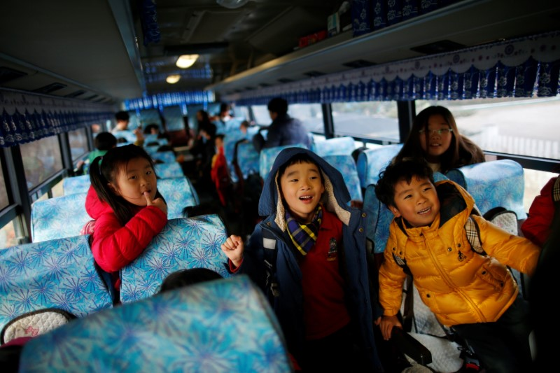 Children on the school bus at the Daesungdong Elementary School inside the demilitarised zone separating the two Koreas, in Paju, South Korea, November 22, 2016.  Photo: Reuters/Kim Hong-Ji