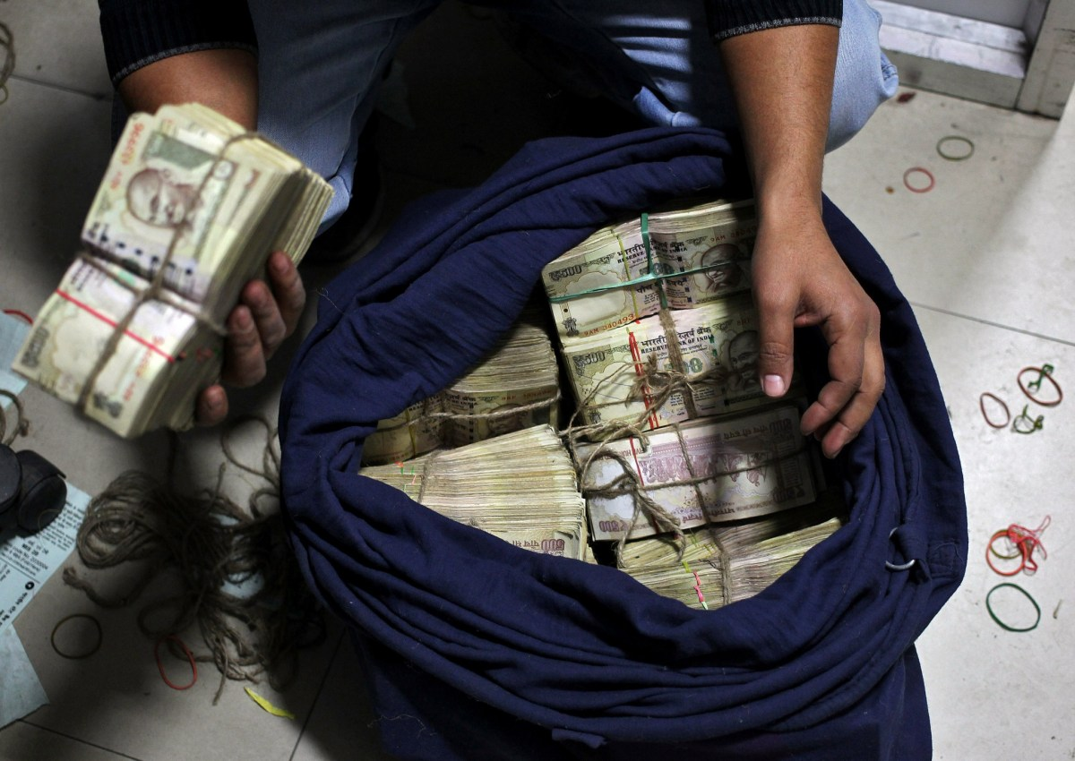 Unexplained cash deposits of scrapped high-denomination bank notes could attract a 50% tax. Photo: Reuters/Mukesh Gupta