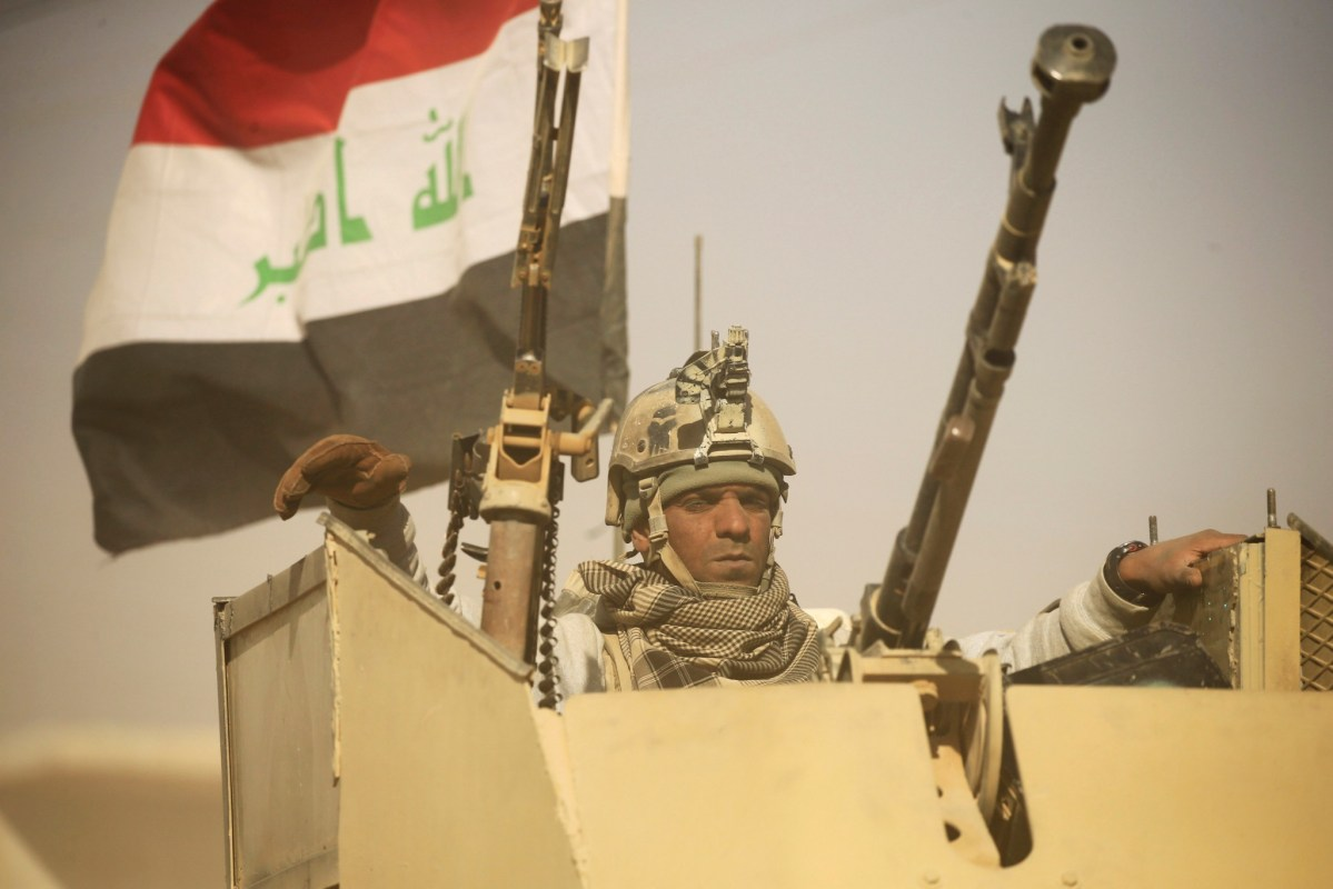 A member of Iraqi army gestures during an operation against Islamic State militants southeast of Mosul, Iraq November 26, 2016. Photo: Reuters/Thaier Al-Sudani