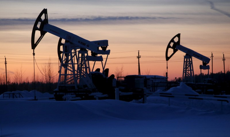 Pump jacks are seen at Lukoil company owned Imilorskoye oil field outside the west Siberian city of Kogalym