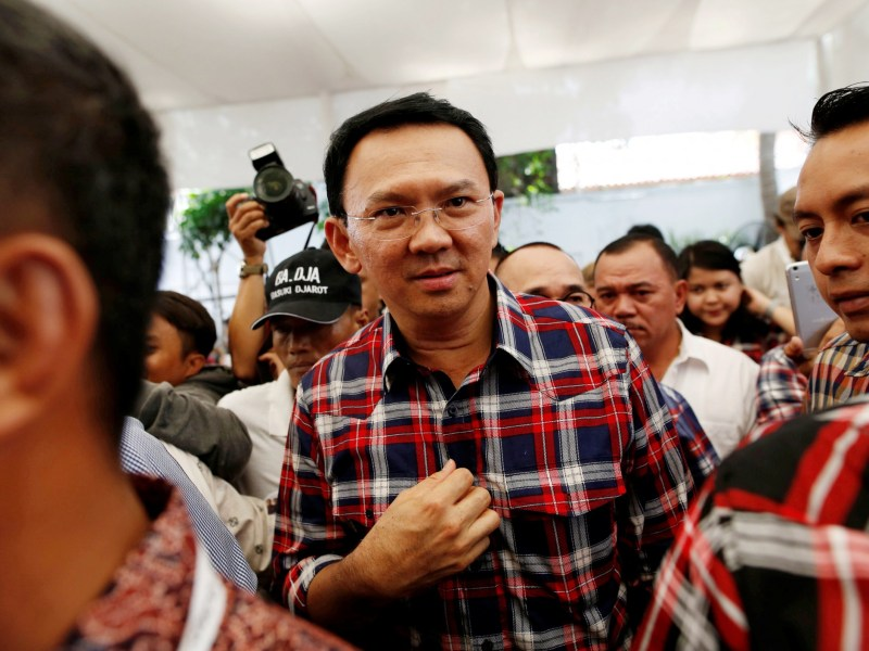 """Jakarta Governor Basuki Tjahaja Purnama, nicknamed """"Ahok"""", leaves the stage after meeting with supporters while campaigning for the election for governor in Jakarta, Indonesia, November 16, 2016. Photo: Reuters/Darren Whiteside"""