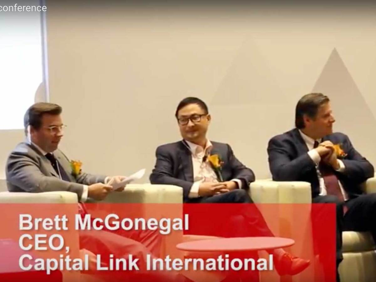 Capital Link International CEO Brett McGonegal (left) moderates a discussion on Fintech at the First Global Advisory Committee Meeting of AMTD on the November 14, 2016 panel. Photo: Asia Times