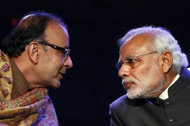 Indian Prime Minister Narendra Modi (R) and Finance Minister Arun Jaitley are trying to persuade businesses and banks to help each other out dealing with bad loans. Photo: Reuters/Anindito Mukherjee