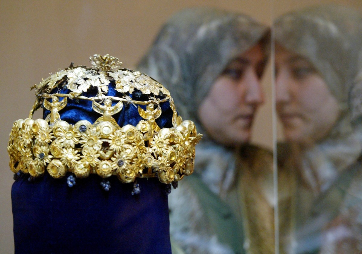 Many of Nimrud's treasures, such as this golden crown on display in a Baghdad museum in 2003, were removed from the site before ISIS forces captured it and blew it up. Photo: Reuters