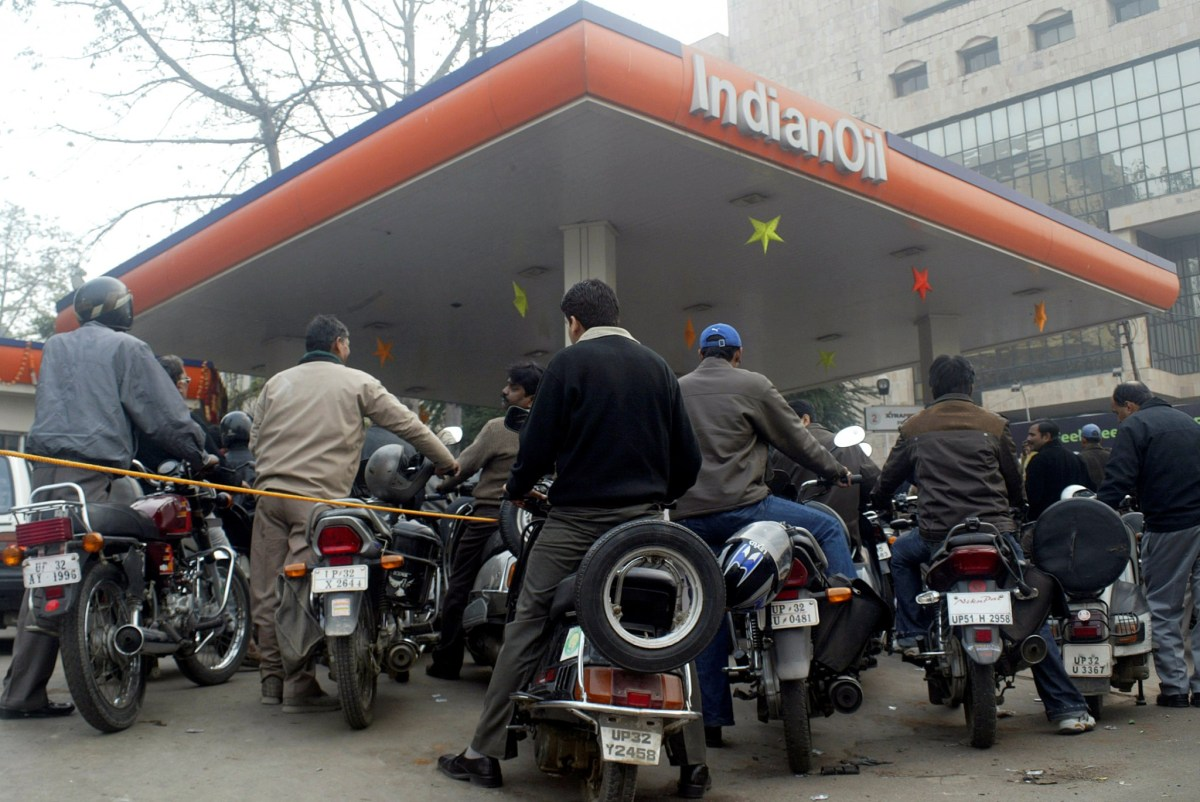 People are lining up at gas stations, which have been told to dispense cash. Photo: REUTERS