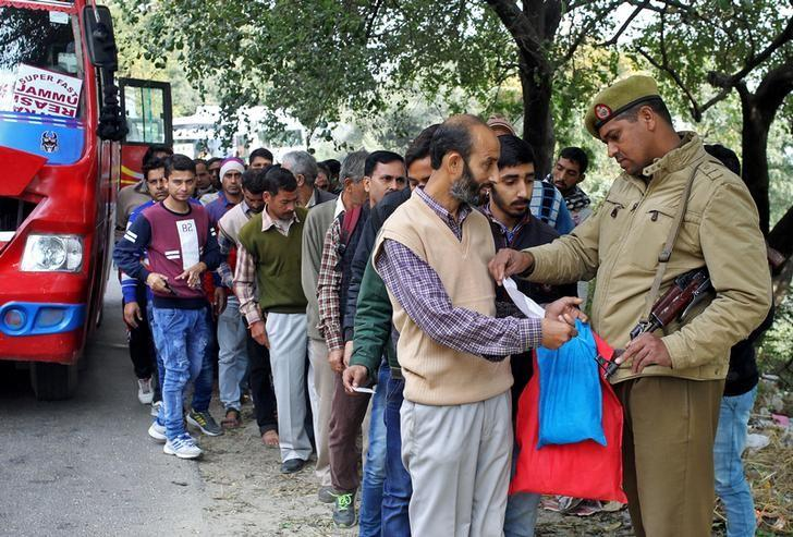 A policeman checks the identity card of a passenger at a checkpoint in Jammu  amid tight security after the terror attack on Nagrota army base early Tuesday. Photo Reuters/Mukesh Gupta