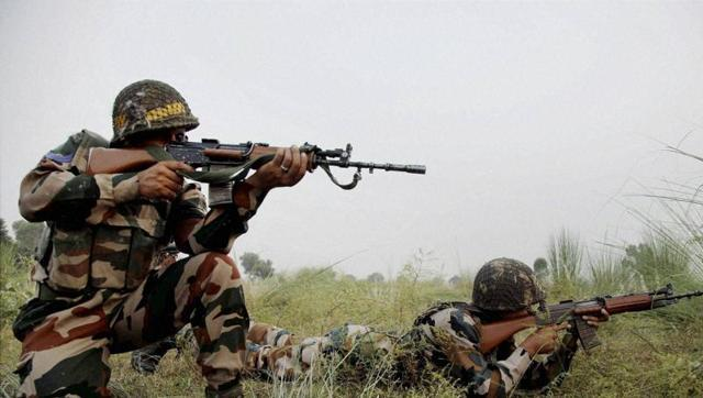 Indian soldiers on alert near the Line of Control in Jammu. Photo: PTI