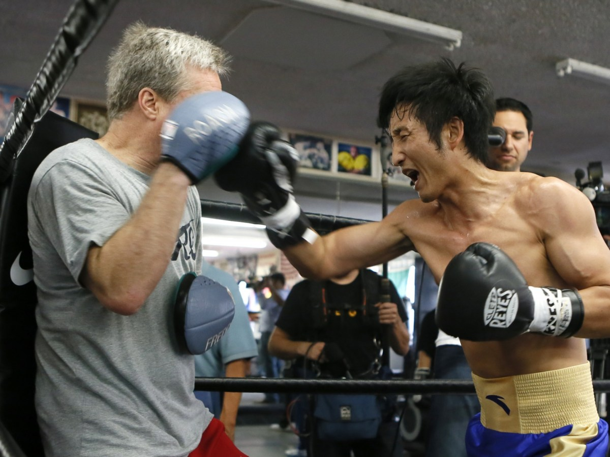 Zou Shiming is 'almost ancient' for a flyweight. Photo: Reuters
