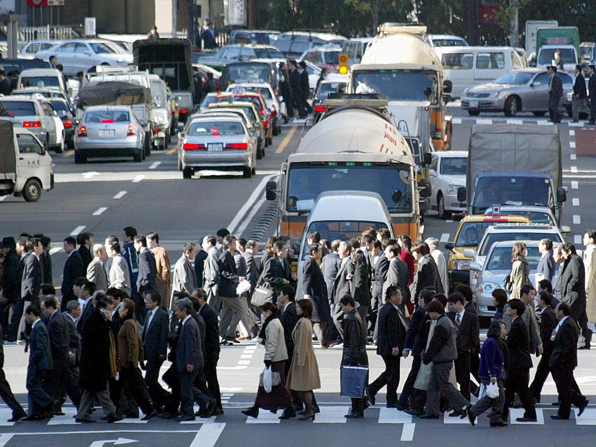Office workers cross a street during their lunch-time break in central Tokyo. Photo: AFP