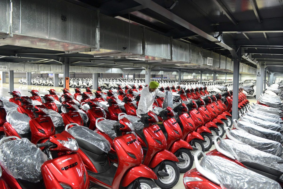 Honda Activa scooters at the stock yard before delivery to different parts of the country. Photo: AFP/ Sam Panthaky