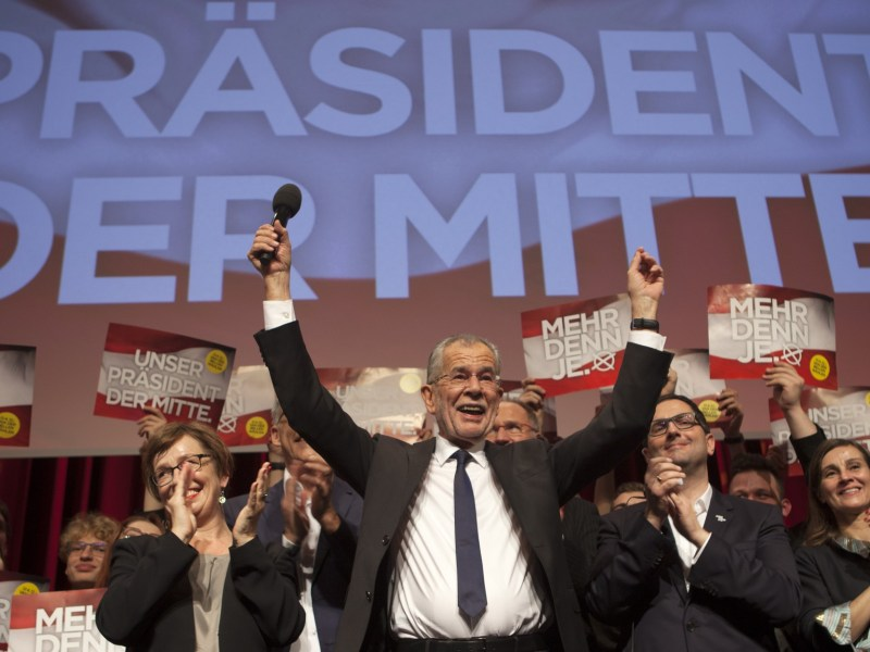 Austrian Presidential candidate Alexander Van der Bellen celebrates with supporters in Vienna. Photo: Alex Halada / AFP
