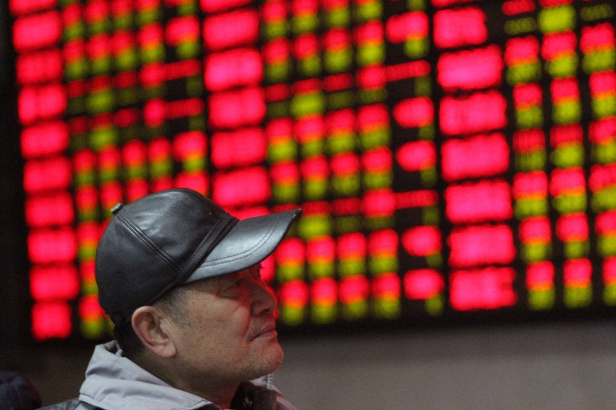 A Chinese investor looks at prices of shares (red for gains) at a stock brokerage house in Nanjing city. Photo: AFP