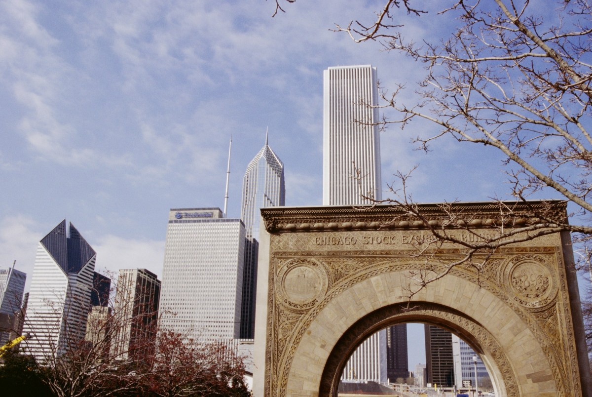 The Old Stock Exchange arch and downtown skyscrapers in Chicago. Chinese investors led by Chongqing Casin Enterprise Group have proposed purchasing a 49.5% stake in the Chicago Stock Exchange. Photo: AFP/Jenny Pate / Robert Harding Heritage