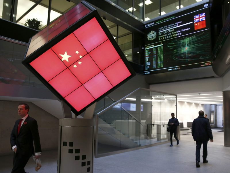 An illuminated cube bearing the Chinese flag is seen in the entrance foyer of the London Stock Exchange in London, Britain November 10, 2016.  REUTERS/Peter Nicholls