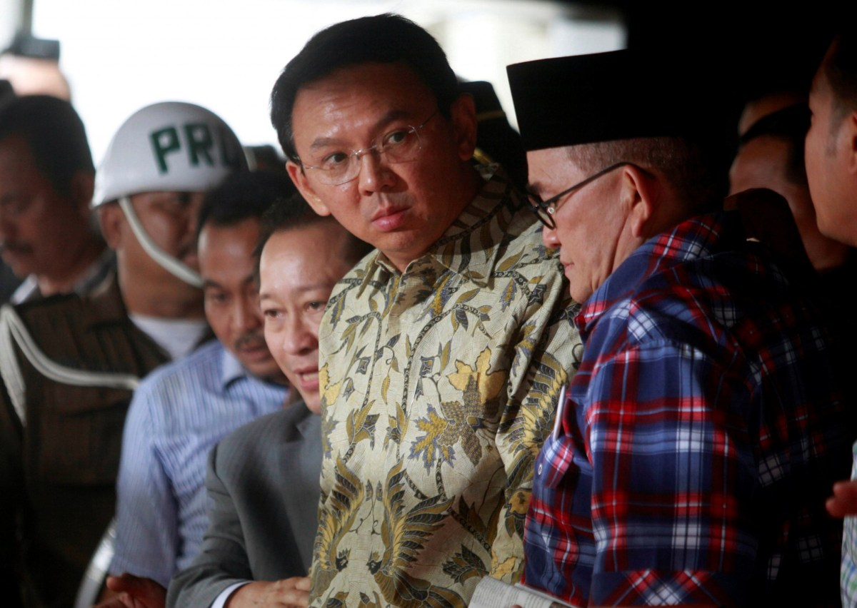 """Jakarta's governor Basuki Tjahaja Purnama, nicknamed """"Ahok"""", leaves a meeting at the Attorney General's office with regards to a blasphemy case in Jakarta, Indonesia. Photo: Reuters, Iqro Rinaldi"""