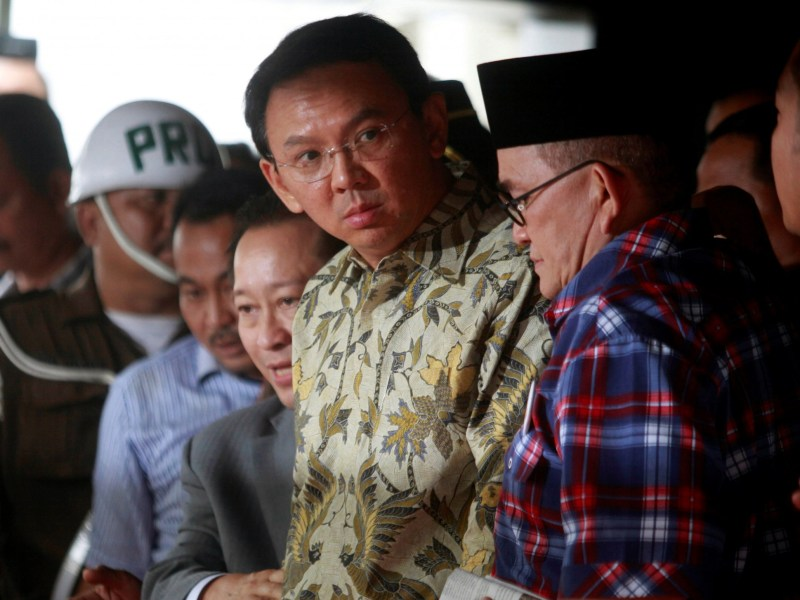 "Jakarta's governor Basuki Tjahaja Purnama, nicknamed ""Ahok"", leaves a meeting at the Attorney General's office with regards to a blasphemy case in Jakarta, Indonesia. Photo: Reuters, Iqro Rinaldi"