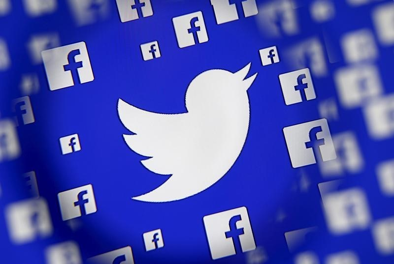 Logo of the Twitter and Facebook are seen through magnifier on display in this illustration taken in Sarajevo, Bosnia and Herzegovina, December 16, 2015.  Photo: Reuters/Dado Ruvic